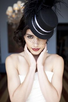 Black veiled mini top hat with black/white ribbon and by orphelia, $100.00