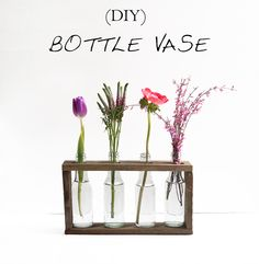 Make this DIY bottle vase out of waste glass and pallet wood. The tutorial is in English and German.
