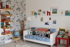 25-original-kids-rooms on babble.  Love this gallery wall and pops of color in a white room