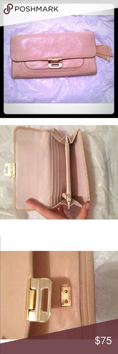 Nini Ricci wallet clutch nude leather Nini Ricci wallet clutch Material: nude leather  Condition: fair preowned condition, **broken clasp on front,**some dark spots on leather through front and back. Retail: $880 Nini Ricci Bags Wallets