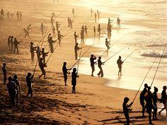 People fish on a beach near Durban.