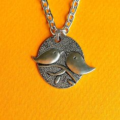 $17.00.  BIRDS of a FEATHER necklace on long chain.  From my favorite vendor.  Tweet kissing.  Adorable.