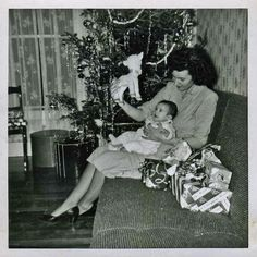 mom with baby and christmas tree