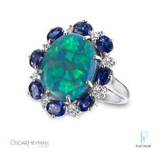 THIS is the one.   Oscar Heyman platinum ring featuring an opal center, surrounded by sapphire & diamonds