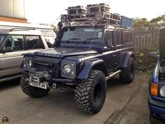 """Land Rover Defender called the """"Ice Rover."""" The staggered roof rack lights are nice looking. The tires must be for soft tundra, as all the Icelandic LR have big tires. Big tires are not usually good for snow and mud, so I don't quite get whats happening."""
