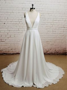 Retro boho style wedding dress with a low plunging neckline and a open back with crisscross strings. Processing Time Standard processing time is approx 8 weeks, peak season may be longer. If you need
