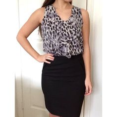 Patterned blouse Black and grey patterned top with ruffle on the front. Elastic at the bottom hem. LOFT Tops Blouses
