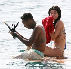 473be690d744b Kendall and Kylie Jenner paddleboard and jet ski in St. Barts