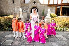 Mexico wedding bright pink flower girls and orange ring bearers