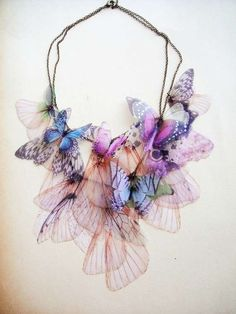 Necklace | Derya Aksoy.  Derya transferred real moth and butterfly wing images onto fabric to create these eye-catching pieces.    Her works definitely make a statement, and their delicate nature adds a very feminine touch. Aksoy likes to use materials such as wire, beads, silk and vintage pieces.
