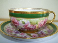This is a lovely cup and saucer marked J P L France J Pouyat Limoges on the saucer. The painting is fabulous and the saucer is about 5 1/4 inches in diameter and the cup is about 1 7/8 inches tall. Th