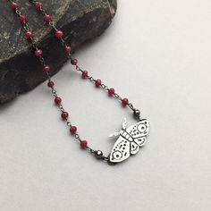 "Edgy & Stylish- Silver Moth Choker is handcrafted with love in pure silver and adorned with dainty red ruby beads. Completed in oxidized sterling silver, this 14"" choker makes a great accent to longer layered chains. ( $70)  #bohojewelry #chokernecklace #insectjewelry"