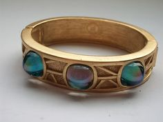 VINTAGE GIVENCHY WIDE BLUE RHINESTONE GOLD  BANGLE CUFF BRACELET PARIS sold for $ 178.59