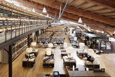 When Tsutaya Bookstores partnered with the City of Takeo Library, the result was a stunning building that the librarians only enough money to stock it with cast off books. By Kay Ohara TOKYO: A local public library… Public Library Design, Library Cafe, City Library, Dream Library, Library Ideas, Grand Library, Library Room, Library Bookshelves, Bookcase
