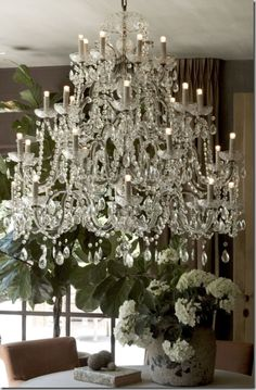 A close up of the chandelier. the accessories on the table are of Belgian design,