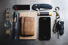 """Everyday carry - EDC: submitted by hufort I've always had a thing for gadgets, and so, I've been """"EDCing"""" since I was a kid without """"knowing it."""" Quote-unquote. I stumbled across this site a little while back, though, and had my eyes opened to the care with which people were approaching the philosophy. It's inspired me to put some real thought into what exactly I bother carrying and how I carry it. So here's what my carry has both grown into and been refined down to: 1969 Submariner that I'm"""