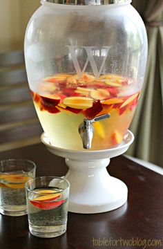 Sparkling Peach Sangria -- 6-8 peaches, sliced, 2 bottles of Riesling, 1 bottle of sparkling wine, 1/2 bottle of peach vodka.  Put everything except the prosecco/sparkling wine in a large pitcher and refrigerate overnight. Before sercing pour in the sparkling wine, stir with wooden spoon and serve.