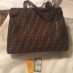100% AUTHENTIC FENDI 8BH267 handbag Brand new with dust bag. It was given to me as a gift and it really doesn't suit me. Tobacco + chestnut color. It's originally priced at $1,250.00 on the tag. Feel free to make reasonable offers :) FENDI Bags