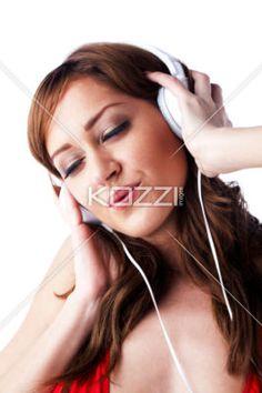 attractive female listening music. - Close-up shot of a beautiful young woman listening to music. Model: Araina Nespiak
