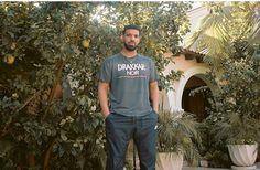 Drake is posing for this picture with his sportswear pants from Nike and his Drakkar Noir printed t-shirt. Old Drake, Drake Ovo, British Rappers, Drake Clothing, Drake Drizzy, Drake Graham, Aubrey Drake, Drake Quotes, Tv Show Games