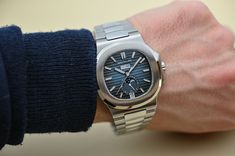 Today we are taking a closer look at the Patek Philippe Nautilus Ref Annual Calendar, complete with new gradient blue dial. Monochrome Watches, Tourbillon Watch, Patek Philippe, Nautilus, Sport Watches, Watch Brands, Precious Metals, Michael Kors Watch, Specs