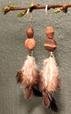 Semi long grey chicken feather earrings