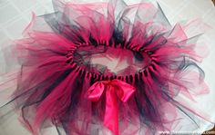 How to make tutu: Final step, sew on bow or any other finishing touch. Can pull beads through every few strands and tie a knot on the end to keep in place.