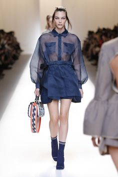 Fendi's latest Spring/Summer 2017 collection embraces rococo opulence and infuses it with contemporary kicks. Sporty boots add an edge to sorbet pastels and French florals. Aprons and Jackets steal the show and are reimagined in stripes, exquisite jacquards, and shimmering sheer fabrics.