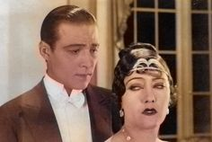 Rudolph Valentino and Gloria Swanson in Beyond The Rocks - a black & white photograph which has been colourised