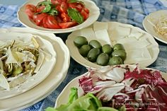 A tempting mix of salads made with artichokes, tomatoes, green and red salad, olives in oil.