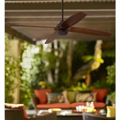 With an oil-rubbed bronze motor and walnut finish wood blades, this ceiling fan offers a bold and modern profile.