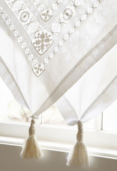 vintage fringed tablecloth as window covering