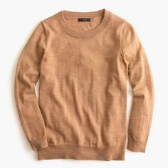 J Crew Tippi Sweater in Camel - comes in PETITE sizes too.  Lightweight Merino, so warm, while also thin, good for layering under jackets/blazers.