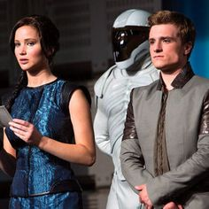 The Hunger Games: Catching Fire Photos Reveal Katniss and Peeta Entering the Quarter Quell - Jennifer Lawrence, Josh Hutcherson, and Liam Hemsworth are featured in this latest look at director Francis Lawrence's upcoming sequel.