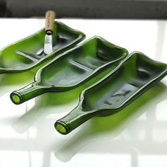 "Not exactly something one can do at home, but a great idea. ""These trays are made from 750 ml wine bottles which have been slumped in the kiln at 1350 degrees. A ceramic mold is used to create raised edges and a tapered handle from the neck of the bottle. They can be used to serve appetizers, small snacks or even as a spoon rest."""