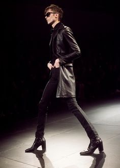 Leather jacket, skinny jeans and cuban heels at Saint Laurent AW15 PFW. See more here: http://www.dazeddigital.com/fashion/article/23376/1/saint-laurent-aw15