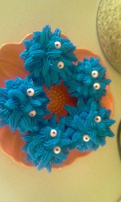 Monster Cupcakes with Wilton Candy Eyes and Blue Buttercream
