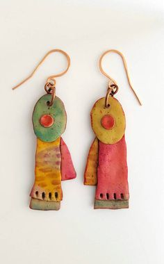 Polymer clay earrings. - Unique organic shape. - Lightweight and easy to wear. - Total length : 7 cm. - Copper earwires. ................................................ Visit my shop to see more of my work. Polymer clay is a magical medium and has endless possibilities! My inspiration is color driven with earthy, organic shapes. I find it fascinating to think of people around the world wearing my jewelry and love receiving photos of them wearing it. Ive made pieces to match special…