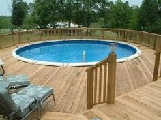 love this decking around the above-ground pool