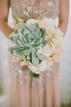 oversized succulent bouquet, photo by Dave Richards http://ruffledblog.com/west-hills-california-wedding #flowers #succulents #uniquebouquets