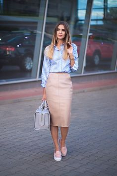 a nude leather midi pencil skirt, a blue and white striped shirt, pink slip ons and a large bag