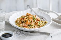 This quick & easy salmon recipe is a tasty twist on classic Chinese-style egg fried rice. Visit Tesco Real Food for more fish recipes & Chinese recipes.