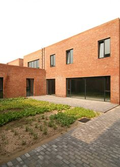 Berlin architecture firm Knowspace created a pair of red brick residences and studios with ridged roofs for two artists in a creative community on the outskirts of Beijing.