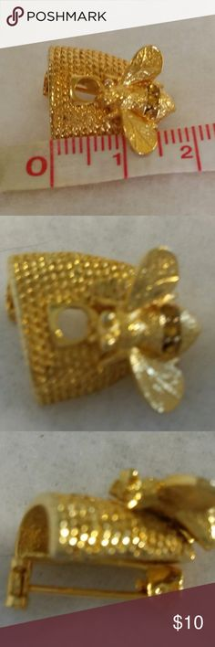 Honeybee hive pin gold tone mini brooch rhinestone This delightful honeybee mini pin or brooch is gold tone metal with 3 amber/tan rhinestone in a band across it's bottom, on a hive is a great gift idea for the bee lover in your life! See photos for size . This came from an estate sale so it is most likely a vintage piece, unmarked. Unmarked Jewelry Brooches