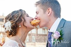 Bride and Groom share a Donut! Wedding cake alternative. Wedding donuts, Cute fun pictures at Highlands Ranch Mansion by Denver Colorado photographer Nicole Nichols Photography
