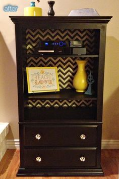 Thrifted dresser with missing drawers, add shelves, wall paper inside. Could also be used as tv stand.