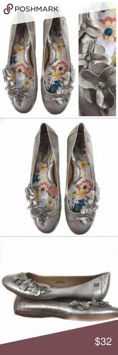 Born silver gold applique flower slip on flat Very nice used condition. Gold and silver flats with leather flower decoration. See pictures for condition and feel free to ask questions prior to purchase. Marked size 12/44. Born Shoes Flats & Loafers
