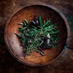 Beautiful herbs in timber bowl. Still life.