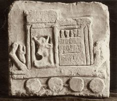 Limestone relief most likely from the sanctuary of Apis at Memphis, present-day location unknown © Griffith Institute, University of Oxford.