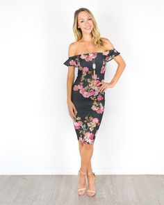 An off the shoulder dress has never been sweeter than our Enchanter Dress! The black backdrop is complemented by pink, sage, and taupe florals throughout. The neckband and sleeves are elastic for a st